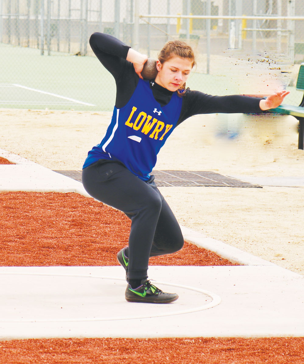 Rachel Garrison warms up in the shot put ring.