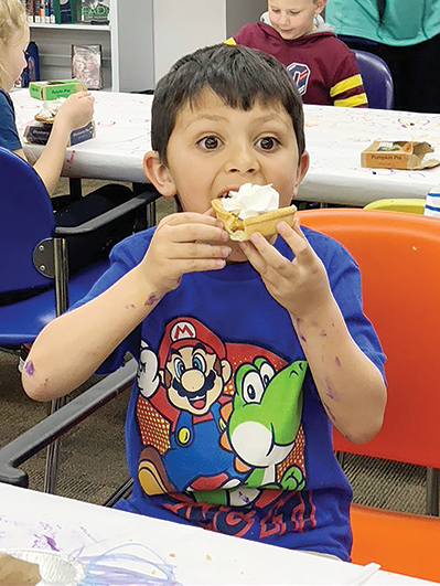 Levi, Castaneda, age 6, enjoys a pumpkin pie in celebration of pi day.