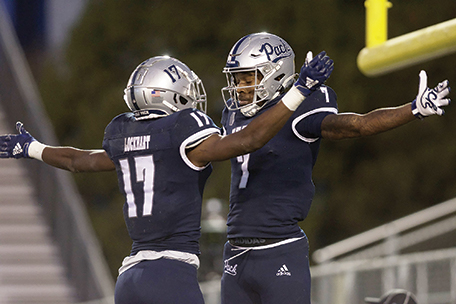 Nevada's Justin Lockhart (left) and Romeo Doubs celebrate Doubs touchdown in the second quarter of Nevada's 34-9 win over Utah State on Thursday night.