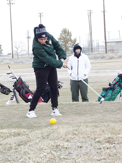 Adriana Robles hits her drive on the first hole.