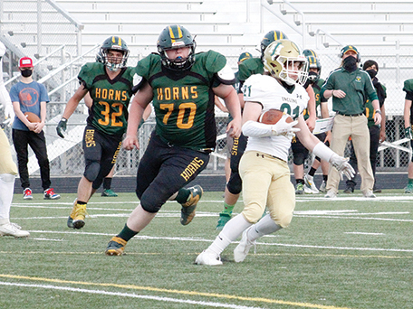 Battle Mountain's Lyle Whitten chases down Incline running back Jakob Hugar during Saturday night's game in Battle Mountain.