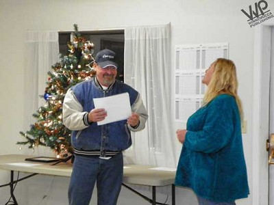 J.P. Hayes (left) accepts his certificate of appreciation and certificates for his wife Joanie and Leo and Marie Menicucci for the work they have done at the St. Cecilia Catholic Mission from Imlay Auxiliary member Sandy Urschel at the Imlay Service Appreciation Ceremony held Dec. 14