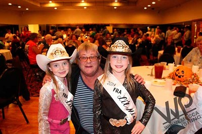 Fernley Rodeo Association Little Miss Alison Greathouse (left), 6, and Emily Greathouse, age 8 (right), pause from their duties as prize runners at the Pershing County DVI soup and salad dinner fundraiser to have their photo taken with PCDVI supporter Wendy Sue.